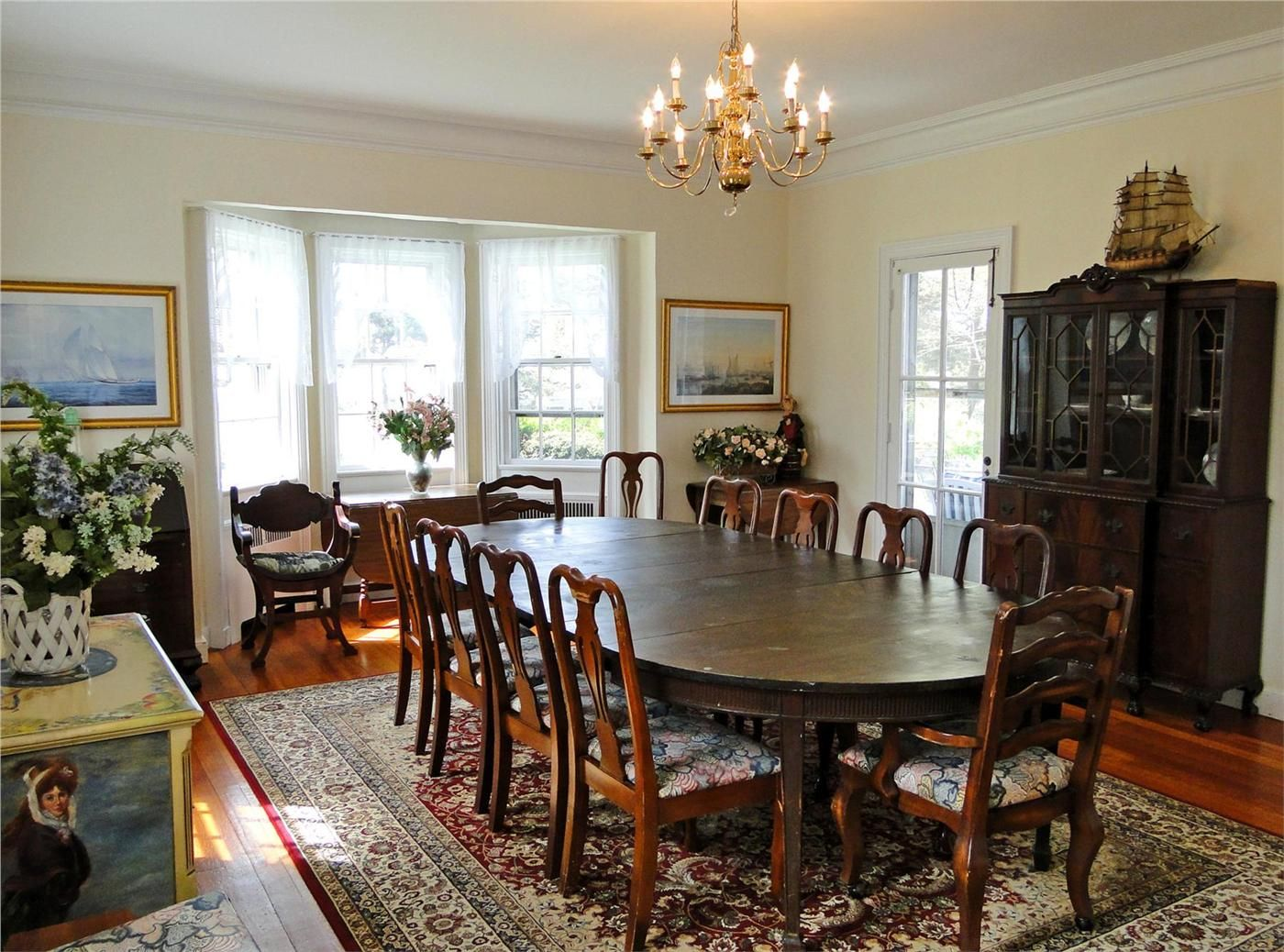 Large dining room with bay window facing water